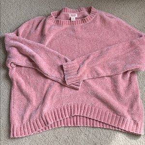 Light pink sweater somewhat cropped